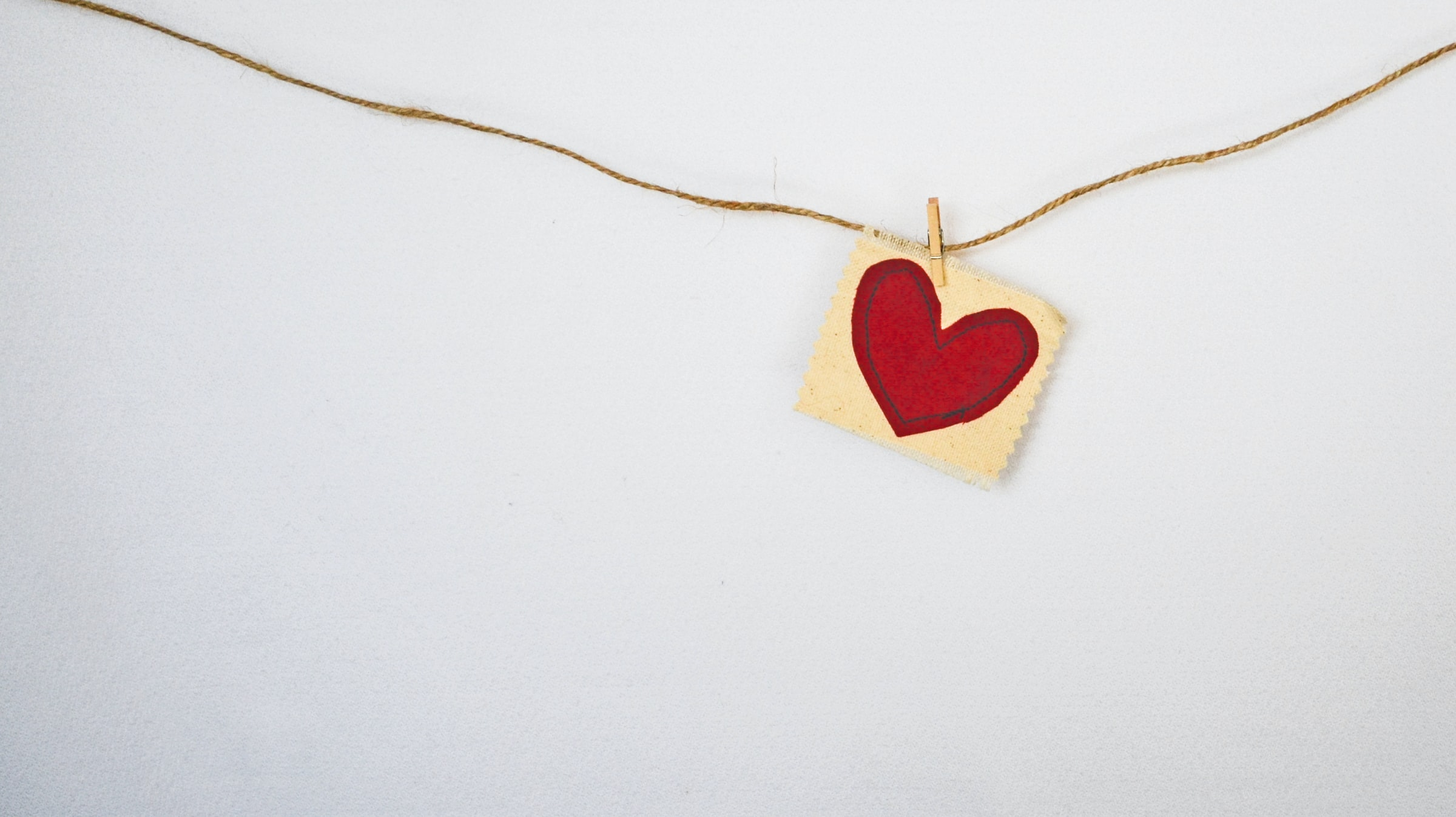 Do You Need a Life Coach? Heart pinned to string on the wall