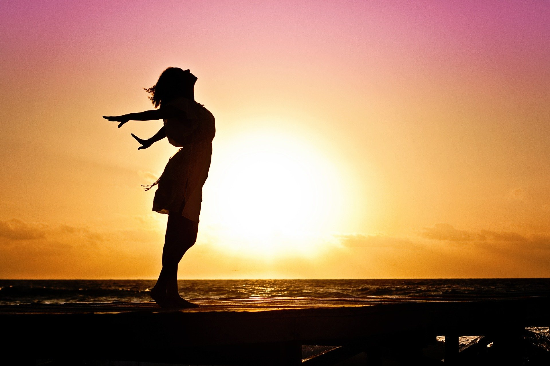 What Can Life Coaching Do For You?. Woman on the Beach being Happy.